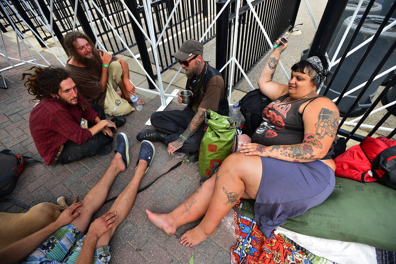 """Teia Maria Boxberger (right)  sits with friends, who asked not to be named, outside of the University of Colorado's Folsom Field in Boulder on Saturday.<br /> More photos:  <a href=""""http://www.dailycamera.com"""">http://www.dailycamera.com</a><br /> (Autumn Parry/Staff Photographer)<br /> July 2, 2016"""