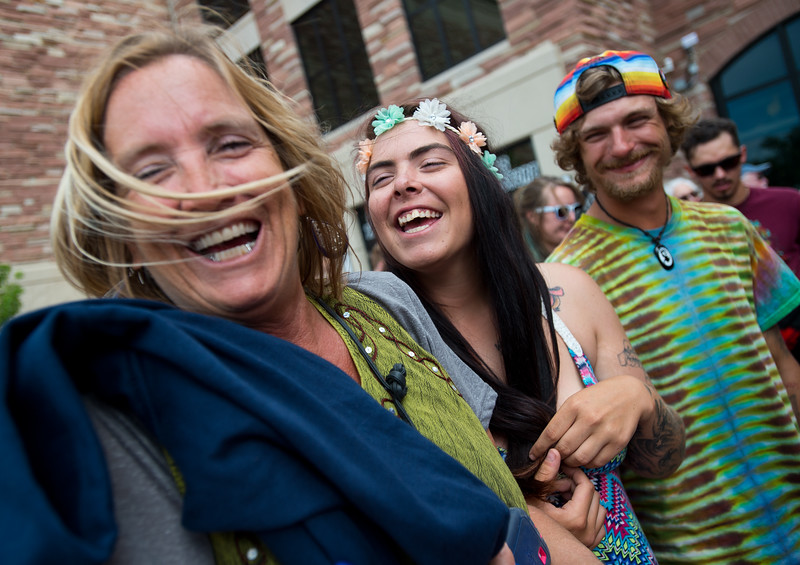 """LuShawn Feverston (left) shares a laugh with her daughter Lacie Feverston and Kyle DeJohn as they wait in line for the Dead & Company Concert at the University of Colorado's Folsom Field in Boulder on Saturday.<br /> More photos:  <a href=""""http://www.dailycamera.com"""">http://www.dailycamera.com</a><br /> (Autumn Parry/Staff Photographer)<br /> July 2, 2016"""