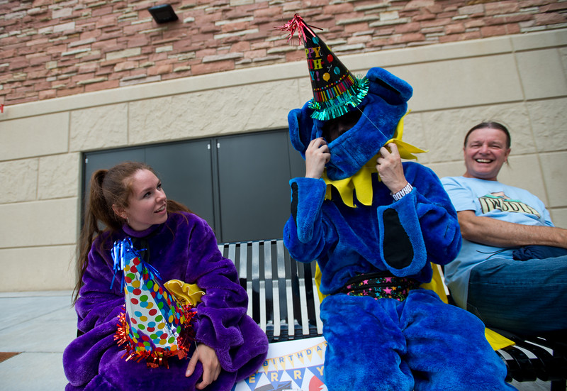 """Vera Farina (left) watches as Travis Blumenthal tries to put a birthday hat over his costume in order to promote the Jerry Garcia Symphonic Celebration which will be held at Red Rocks Amphitheater in August. <br /> More photos:  <a href=""""http://www.dailycamera.com"""">http://www.dailycamera.com</a><br /> (Autumn Parry/Staff Photographer)<br /> July 2, 2016"""