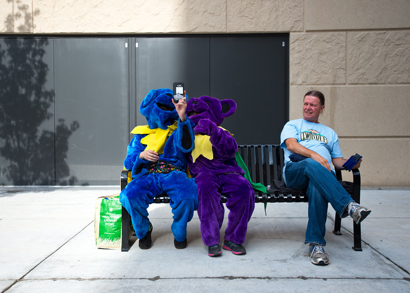 "Travis Blumenthal and Vera Farina, with AEG, take a photo of themselves dressed as the dancing bears while sitting next to Charlie Connor, who traveled from Connecticut to attend the Dead & Company concert, outside of the University of Colorado's Folsom Field in Boulder on Saturday.<br /> More photos:  <a href=""http://www.dailycamera.com"">http://www.dailycamera.com</a><br /> (Autumn Parry/Staff Photographer)<br /> July 2, 2016"