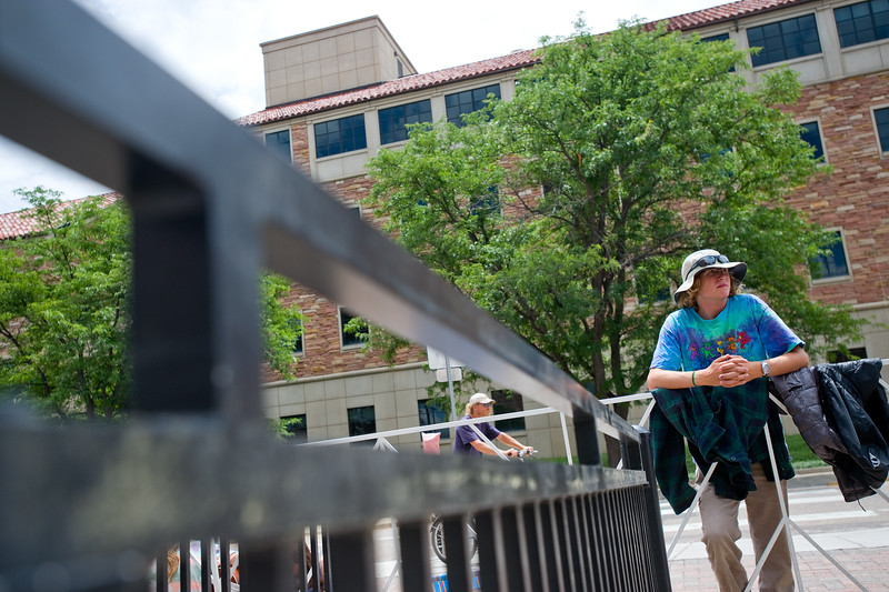 """Cole Mystrom, a sophomore at CU Boulder, waits outside Folsom Field for the Dead & Company concert in Boulder on Saturday. <br /> More photos:  <a href=""""http://www.dailycamera.com"""">http://www.dailycamera.com</a><br /> (Autumn Parry/Staff Photographer)<br /> July 2, 2016"""
