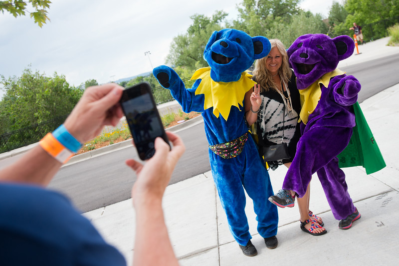 """Tonya Roedell has her photo taken with the dancing bears, Travis Blumenthal (left) and Vera Farina (right), prior to the Dead & Company concert at the University of Colorado's Folsom Field in Boulder on Saturday.<br /> More photos:  <a href=""""http://www.dailycamera.com"""">http://www.dailycamera.com</a><br /> (Autumn Parry/Staff Photographer)<br /> July 2, 2016"""
