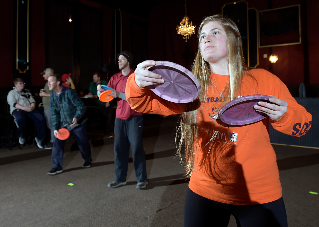 . LONGMONT, CO - JANUARY 8: Maui Shipkey warms up before an indoor disc golf tournament at the Dickens Opera House January 8, 2019. (Photo by Lewis Geyer/Staff Photographer)