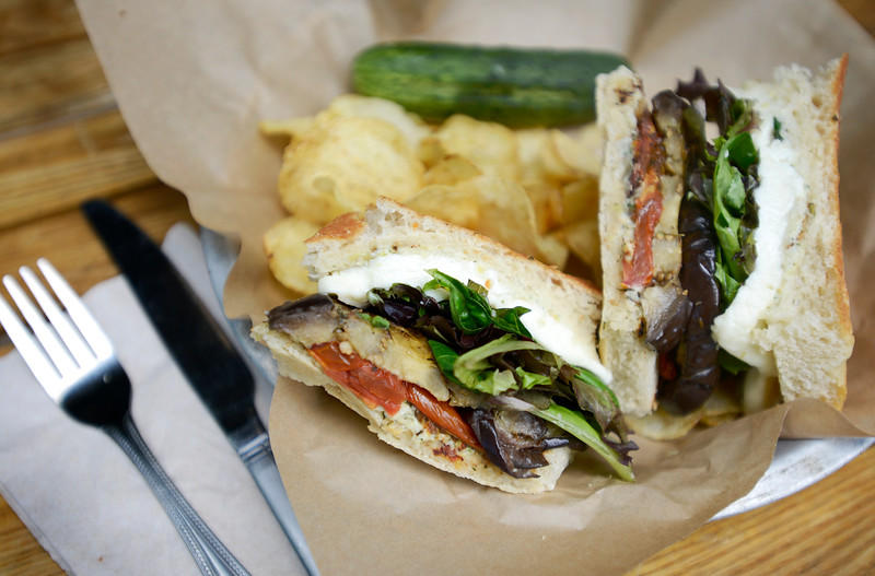 """""""Aubergine Sandwich"""" with marinated eggplant, artichoke spread, house roasted tomatoes, 'dish' mozz, field greens, on focaccia bread  at the Dish Gourmet in Boulder on Tuesday. For more photos go to  <a href=""""http://www.dailycamera.com"""">http://www.dailycamera.com</a><br /> <br /> Devi Chung For The Camera. June 14, 2016"""