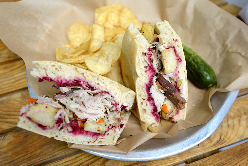 """""""Thanksgiving Sandwich"""" with 'diestel' natural turkey, cranberry, stuffing, gravy, on ciabatta bread at the Dish Gourmet in Boulder on Tuesday. For more photos go to  <a href=""""http://www.dailycamera.com"""">http://www.dailycamera.com</a><br /> Devi Chung For The Camera. June 14, 2016"""