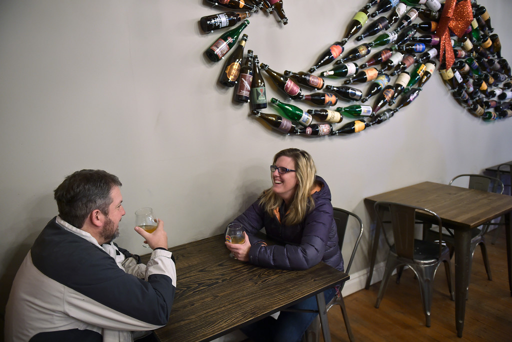 . Tim and Sherri Barksdale have a drink at The Old Mine Cidery and Brew Pub in downtown Erie Friday evening. Lewis Geyer/Staff Photographer Dec. 22, 2017