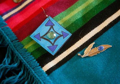 Donated earrings are affixed to a blanket that will be part of the traveling Sing Our Rivers Red exhibit. (Shaun Walker -- The Times-Standard)