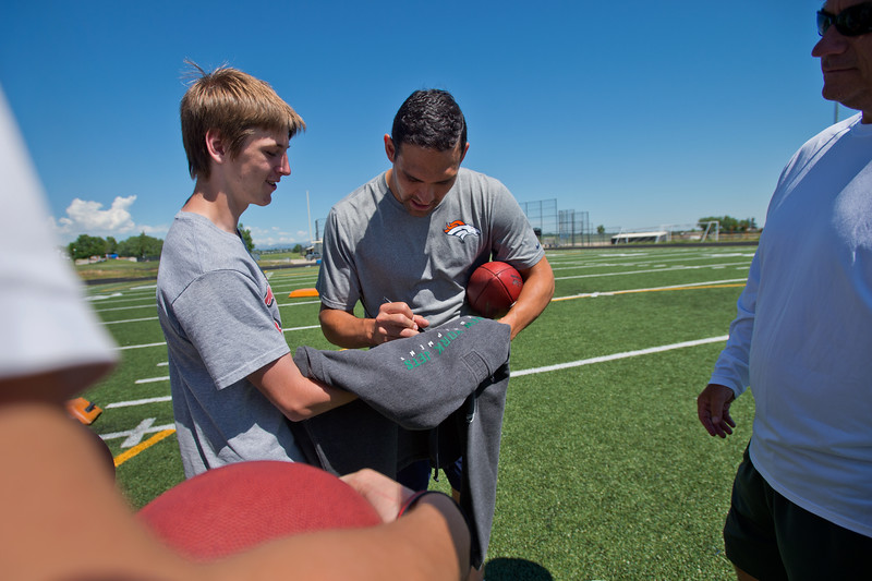 "Denver Broncos quarterback Mark Sanchez signs a hoodie he gifted Kyle Gambino years ago, during the East County Football Camp at Monarch High School on Saturday.<br /> More photos:  <a href=""http://www.BoCoPreps.com"">http://www.BoCoPreps.com</a><br /> (Autumn Parry/Staff Photographer)<br /> June 11, 2016"