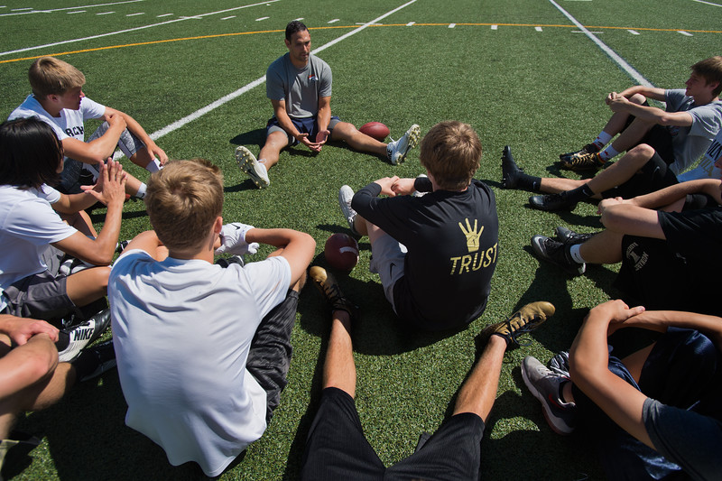 """Students gather around to listen to Denver Broncos quarterback Mark Sanchez during the East County Football Camp at Monarch High School on Saturday. """"Pray like everything depends on god, but play like everything depends on you,"""" said Sanchez. <br /> More photos:  <a href=""""http://www.BoCoPreps.com"""">http://www.BoCoPreps.com</a><br /> (Autumn Parry/Staff Photographer)<br /> June 11, 2016"""
