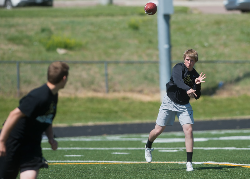 "Monarch's quarterback Jonston MacIntyre passes the ball to a student during the East County Football Camp at Monarch High School on Saturday. <br /> More photos:  <a href=""http://www.BoCoPreps.com"">http://www.BoCoPreps.com</a><br /> (Autumn Parry/Staff Photographer)<br /> June 11, 2016"