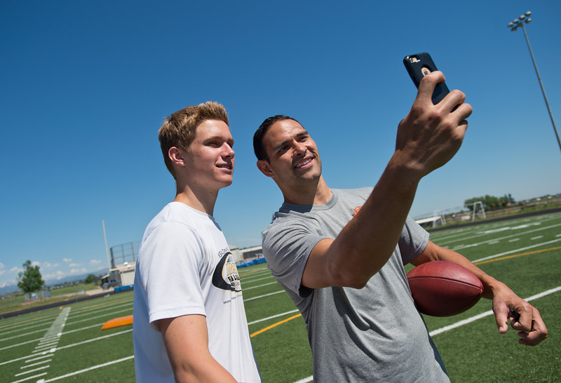 "Denver Broncos quarterback Mark Sanchez takes a photo with Max Ryterski, a junior at Monarch High School, during the East County Football Camp on Saturday. <br /> More photos:  <a href=""http://www.BoCoPreps.com"">http://www.BoCoPreps.com</a><br /> (Autumn Parry/Staff Photographer)<br /> June 11, 2016"