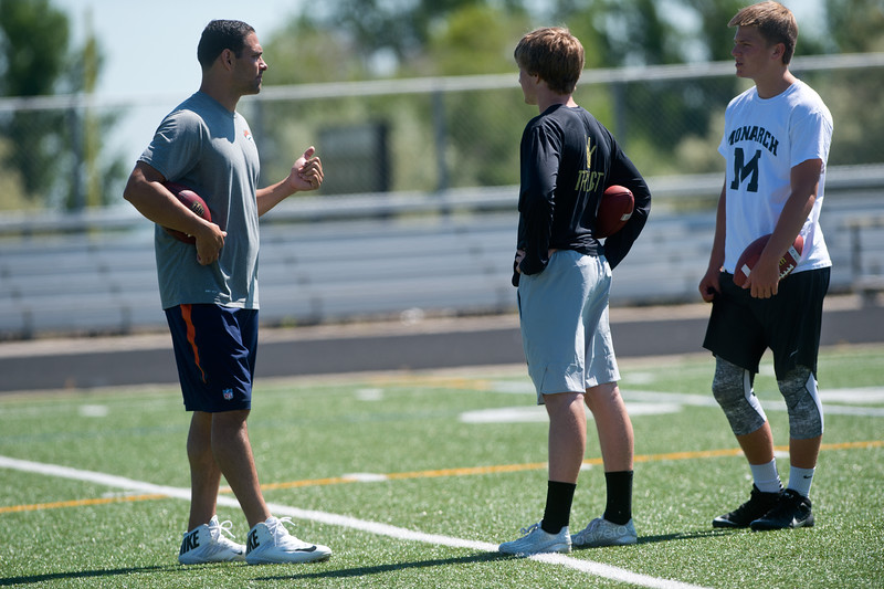 "Denver Broncos quarterback Mark Sanchez coaches Monarch's quarterback Jonston MacIntyre (center) and C.J. Schmanski, a junior at Monarch High School,  during the East County Football Camp on Saturday. <br /> More photos:  <a href=""http://www.BoCoPreps.com"">http://www.BoCoPreps.com</a><br /> (Autumn Parry/Staff Photographer)<br /> June 11, 2016"