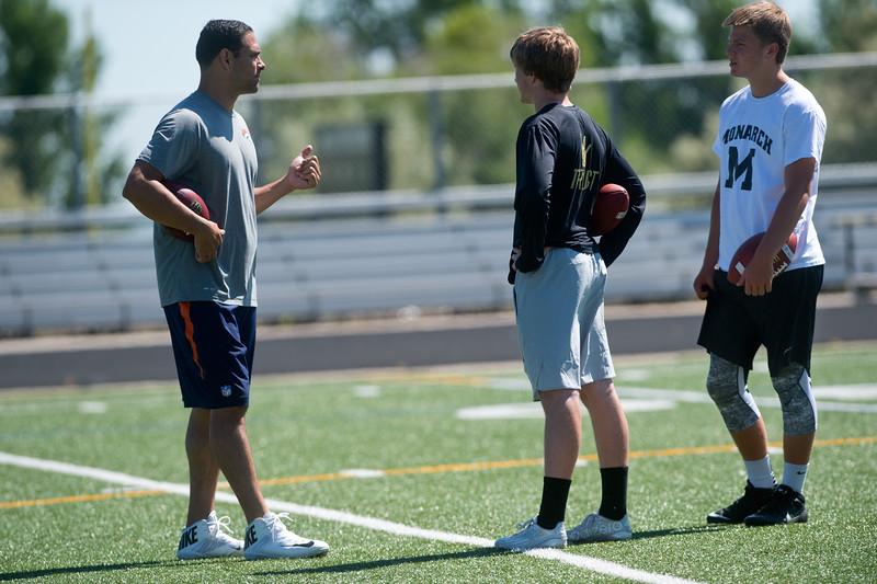 "Denver Broncos quarterback Mark Sanchez coaches Monarch's quarterback Jonston MacIntyre (center) and C.J. Schmanski, a junior at Monarch High School,  during the East County Football Camp on Saturday. <br /> More photos:  <a href=""http://www.BoCoPreps.com"">http://www.BoCoPreps.com</a><br /> (Autumn Parry/Staff Photographer)<br /> June 11, 2016"