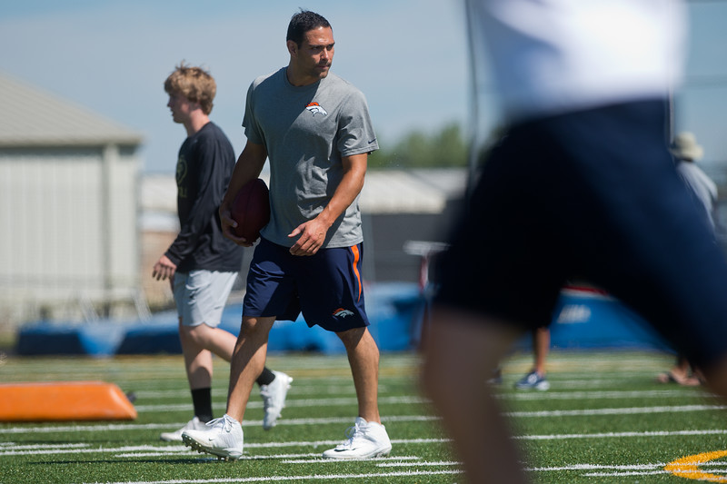 "Denver Broncos quarterback Mark Sanchez coaches students during the East County Football Camp at Monarch High School on Saturday. <br /> More photos:  <a href=""http://www.BoCoPreps.com"">http://www.BoCoPreps.com</a><br /> (Autumn Parry/Staff Photographer)<br /> June 11, 2016"
