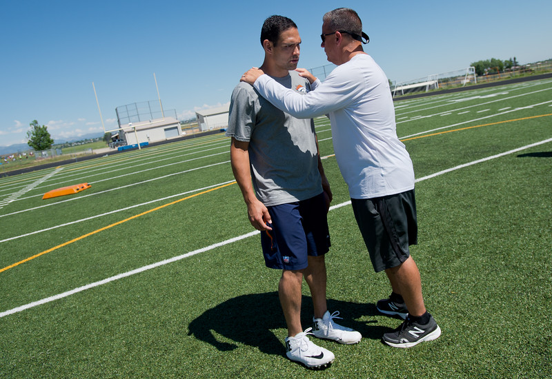 "Monarch High School's football coach Phil Bravo speaks with Denver Broncos quarterback Mark Sanchez during the East County Football Camp at Monarch High School on Saturday. <br /> More photos:  <a href=""http://www.BoCoPreps.com"">http://www.BoCoPreps.com</a><br /> (Autumn Parry/Staff Photographer)<br /> June 11, 2016"