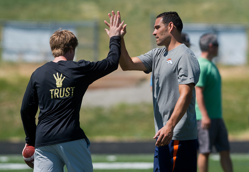 "Denver Broncos quarterback Mark Sanchez high fives Monarch's quarterback Jonston MacIntyre during the East County Football Camp at Monarch High School on Saturday. <br /> More photos:  <a href=""http://www.BoCoPreps.com"">http://www.BoCoPreps.com</a><br /> (Autumn Parry/Staff Photographer)<br /> June 11, 2016"
