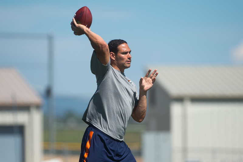 """Denver Broncos quarterback Mark Sanchez passes the ball to a student during the East County Football Camp at Monarch High School on Saturday. <br /> More photos:  <a href=""""http://www.BoCoPreps.com"""">http://www.BoCoPreps.com</a><br /> (Autumn Parry/Staff Photographer)<br /> June 11, 2016"""