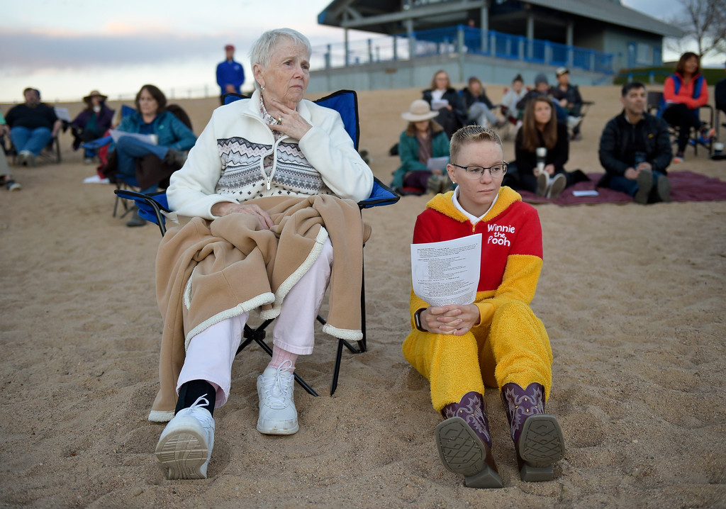 ". BOULDER, CO - APRIL 21: Missie Coneybeer, left, and Elizabeth Siverling listen to the Easter Sunrise Celebration at Boulder Reservoir April 21, 2019. Hosted by Shepherd of the Hills and Trinity Lutheran Churches, the service has been conducted at the reservoir for over 20 years. Coneybeer, who has lived in South Carolina for three years, still returns to Boulder for Holy Week. Warm temperatures greeted attendees at this year\'s service. ""I\'ve been out here when the sand is frozen,\"" Coneybeer said. To view more photos visit dailycamera.com. (Photo by Lewis Geyer/Staff Photographer)"