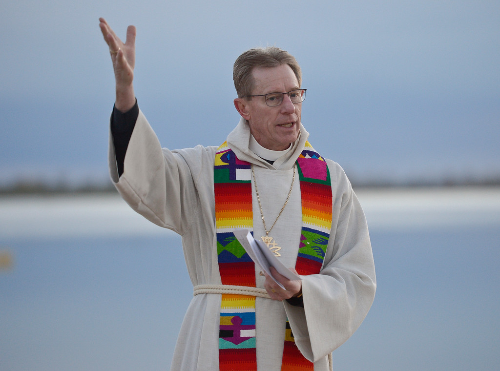 . BOULDER, CO - APRIL 21: Reverend Mark Twietmeyer gives the sermon for the Easter Sunrise Celebration at Boulder Reservoir April 21, 2019. Hosted by Shepherd of the Hills and Trinity Lutheran Churches, the service has been conducted at the reservoir for over 20 years. To view more photos visit dailycamera.com. (Photo by Lewis Geyer/Staff Photographer)