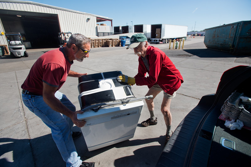 "Supervisor Scotty Mordja helps Barry Satlow remove an old dishwasher from his car, which will be recycled at Eco-Cycles' Center for Hard-to Recycle Materials (CHaRM) in Boulder on Friday. Eco-Cycle, a non-profit recycling center, recently celebrated its 40th anniversary. <br /> More photos:  <a href=""http://www.dailycamera.com"">http://www.dailycamera.com</a><br /> (Autumn Parry/Staff Photographer)<br /> September 9, 2016"