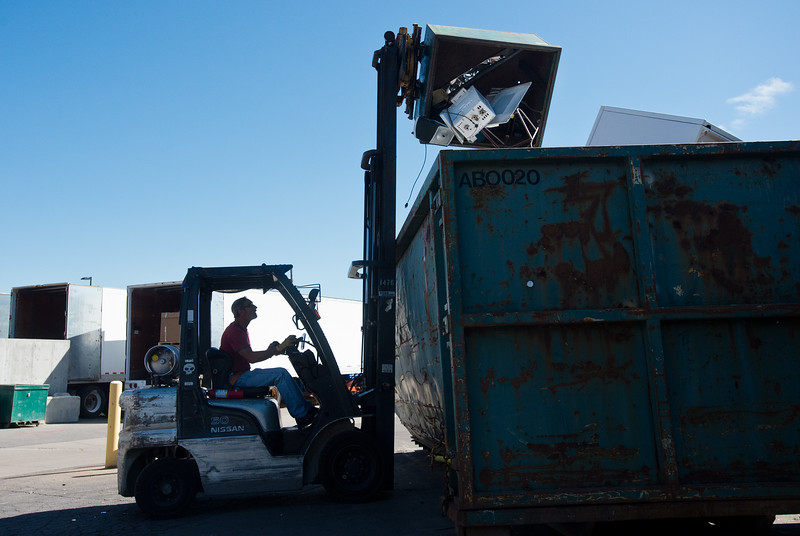 "Supervisor Scotty Mordja uses a forklift to empty large household items into a bin at Eco-Cycles' Center for Hard-to Recycle Materials (CHaRM) in Boulder on Friday. Eco-Cycle, a non-profit recycling center, recently celebrated its 40th anniversary. <br /> More photos:  <a href=""http://www.dailycamera.com"">http://www.dailycamera.com</a><br /> (Autumn Parry/Staff Photographer)<br /> September 9, 2016"