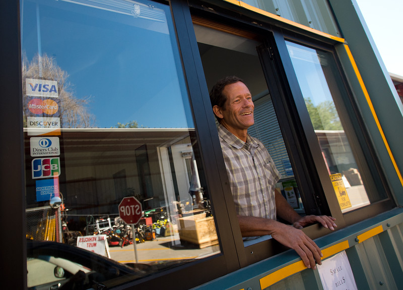 "Matt Patrick greets visitors at the front window and directs them where to leave their recyclable items at Eco-Cycles' Center for Hard-to Recycle Materials (CHaRM) in Boulder on Friday. Eco-Cycle, a non-profit recycling center, recently celebrated its 40th anniversary. <br /> More photos:  <a href=""http://www.dailycamera.com"">http://www.dailycamera.com</a><br /> (Autumn Parry/Staff Photographer)<br /> September 9, 2016"