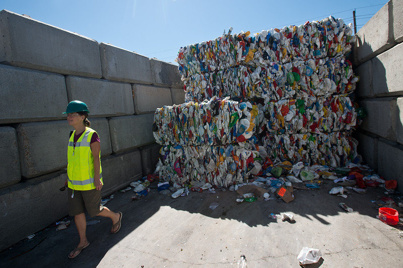 "Harlin Savage, the communications director for Eco-Cycle, walks by bails of plastic which will be recycled at the Boulder County Recycling Center on Friday. Eco-Cycle, a non-profit recycling center, recently celebrated its 40th anniversary. <br /> More photos:  <a href=""http://www.dailycamera.com"">http://www.dailycamera.com</a><br /> (Autumn Parry/Staff Photographer)<br /> September 9, 2016"