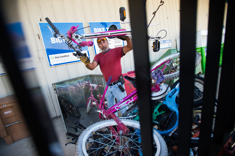"Supervisor Scotty Mordja piles used bicycles onto a forklift at Eco-Cycles' Center for Hard-to Recycle Materials (CHaRM) in Boulder on Friday. Eco-Cycle, a non-profit recycling center, recently celebrated its 40th anniversary. <br /> More photos:  <a href=""http://www.dailycamera.com"">http://www.dailycamera.com</a><br /> (Autumn Parry/Staff Photographer)<br /> September 9, 2016"