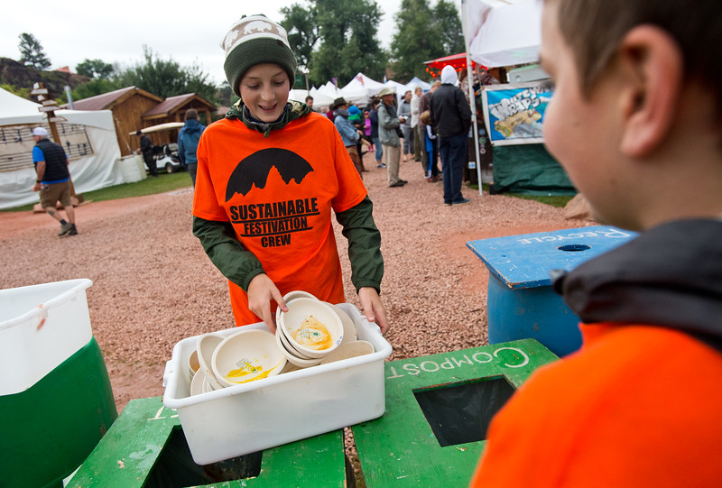 """Sam Dorschel, 12, gathers reusable eco-plates from a compost and recycling station at the Folks Fest in Lyons. <br /> More photos:  <a href=""""http://www.dailycamera.com"""">http://www.dailycamera.com</a><br /> (Autumn Parry/Staff Photographer)<br /> August 19, 2016"""