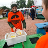 "Sam Dorschel, 12, gathers reusable eco-plates from a compost and recycling station at the Folks Fest in Lyons. <br /> More photos:  <a href=""http://www.dailycamera.com"">http://www.dailycamera.com</a><br /> (Autumn Parry/Staff Photographer)<br /> August 19, 2016"