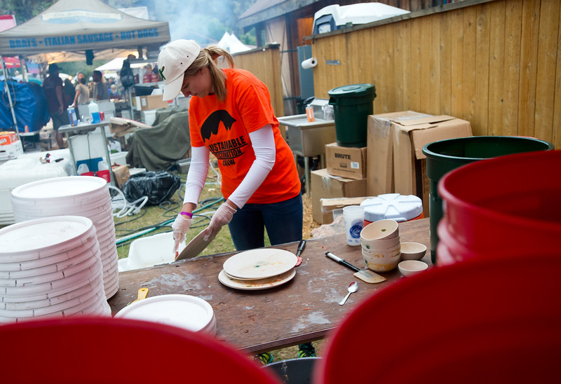 "Zoe Neuhard, 17, from Lyons Middle/Senior High School, clears food off eco-plates, which will be washed and reused at the Folks Fest in Lyons.<br /> More photos:  <a href=""http://www.dailycamera.com"">http://www.dailycamera.com</a><br /> (Autumn Parry/Staff Photographer)<br /> August 19, 2016"