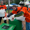 "Grant Gau, 12, (center) and Sam Dorschel, 12, (right) dispose of compostable waste at the Folks Fest in Lyons on Friday.<br /> More photos:  <a href=""http://www.dailycamera.com"">http://www.dailycamera.com</a><br /> (Autumn Parry/Staff Photographer)<br /> August 19, 2016"