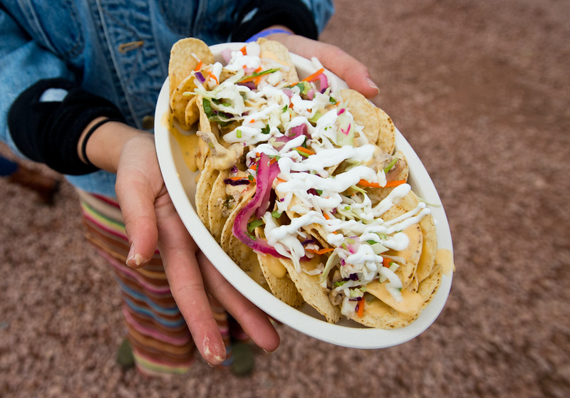 """Mia Sadowsky ordered nachos that were served in an eco-plate, at the Folks Fest in Lyons on Friday. Planet Bluegrass invested $15,000 in cutting edge eco-plates made from bamboo, sugar cane and corn, which are both compostable and reusable.<br /> More photos:  <a href=""""http://www.dailycamera.com"""">http://www.dailycamera.com</a><br /> (Autumn Parry/Staff Photographer)<br /> August 19, 2016"""