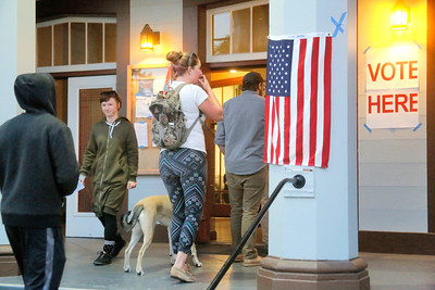 Voters line up outside the Arcata Veterans Memorial Building early Tuesday evening. (Shaun Walker -- The Times-Standard)
