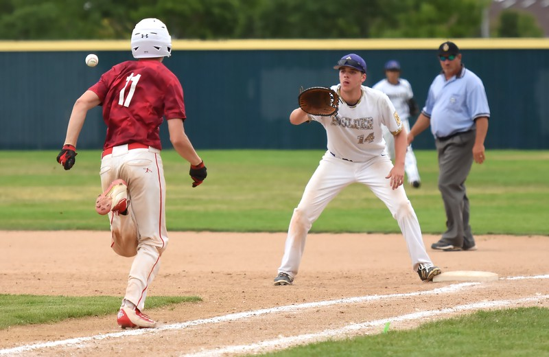 Boulder's Jackson Dinkel receives a throw from catcher Tommy Wymore to record an out at first base during the Panthers' Legion B state championship game against Elizabeth on Sunday at Machebeuf High School.