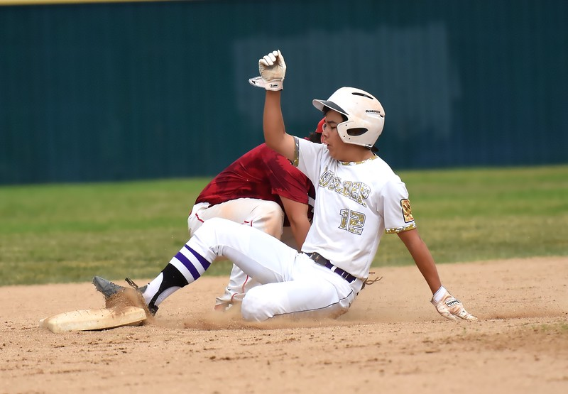 Nathaniel Lim slides into second base during the Panthers' Legion B state championship game against Elizabeth on Sunday at Machebeuf High School.