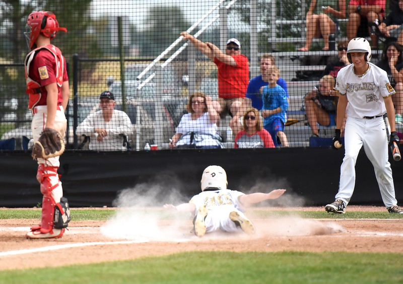 Boulder's Charlie Esson slides across home plate in the third inning during the Panthers' Legion B state championship game against Elizabeth on Sunday at Machebeuf High School.