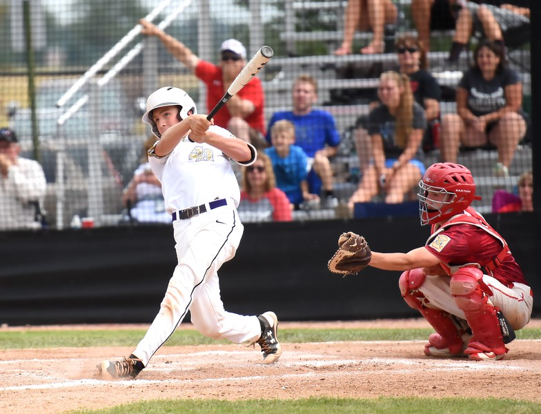 Boulder's Tommy Wymore smashes a ball down the left-field line during the Panthers' Legion B state championship game against Elizabeth on Sunday at Machebeuf High School.