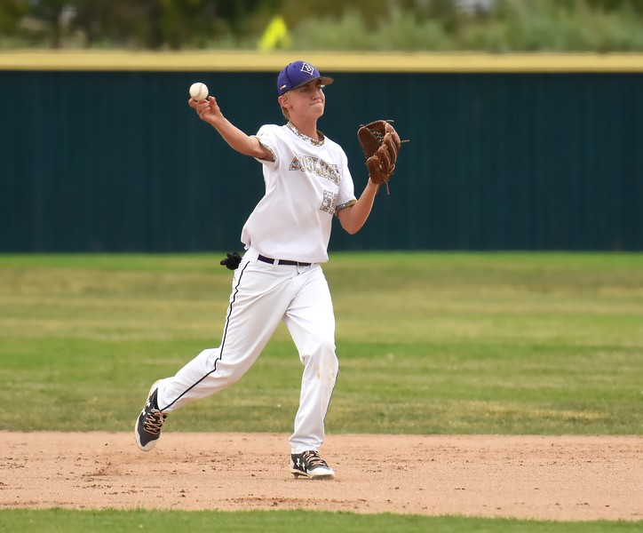 Boulder second baseman Sean Coan makes a throw to first during the Panthers' Legion B state championship game against Elizabeth on Sunday at Machebeuf High School.