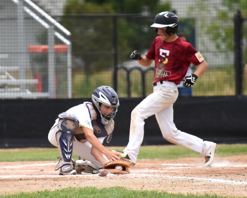 Boulder's Tommy Wymore collects a long throw from the outfield a half-second too late to catch a scoring runner during the Panthers' Legion B state championship game against Elizabeth on Sunday at Machebeuf High School.
