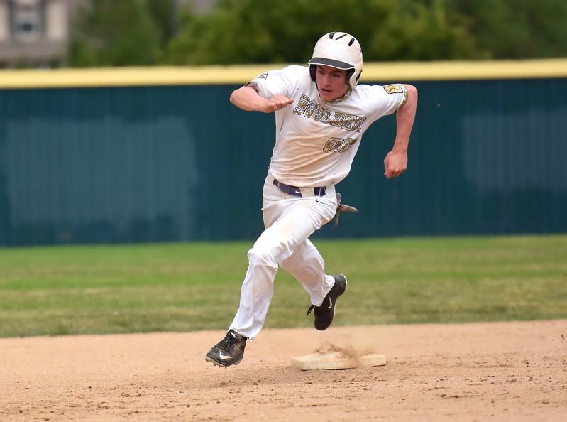 Boulder's Charlie Esson rounds second base on his way to scoring a run in the third inning during the Panthers' Legion B state championship game against Elizabeth on Sunday at Machebeuf High School.