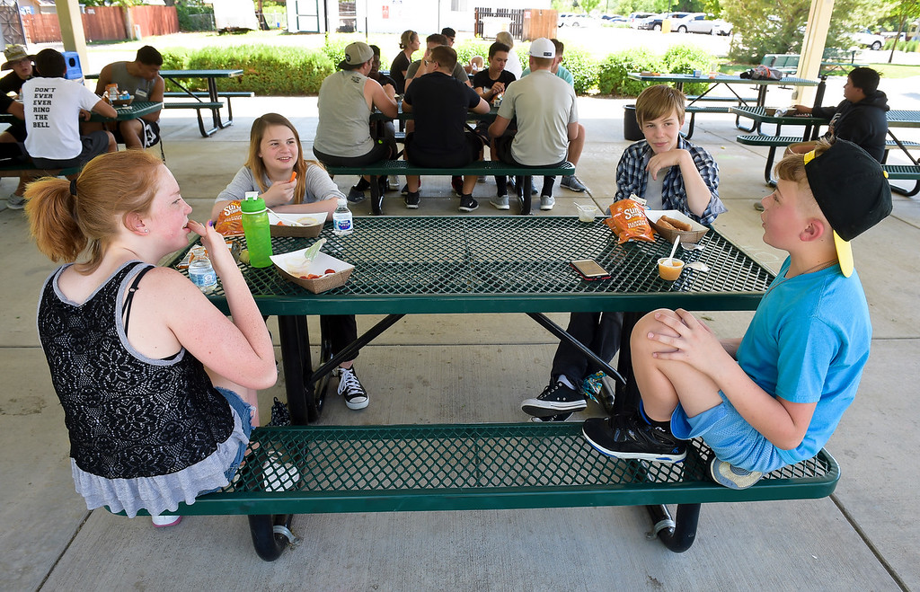 . From left: Hanna Hassell, 12, Allison Lewis, 11, Jaden Ross, 12, and Jacobe Jordan, 11, have lunch at Coal Miner\'s Park in Erie Tuesday. Erie UpLink is partnering with St. Vrain Valley School District to provide free lunch for Erie children 18 and under as part of the USDA Summer Meals Program. To view more photos visit timescall.com. Lewis Geyer/Staff Photographer June 05, 2018