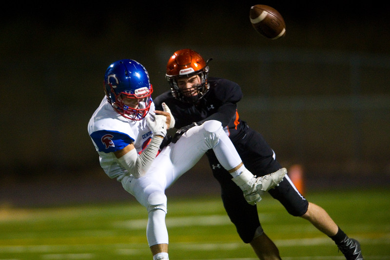 "Centaurus' Anthony Losasso  tries to intercept a pass meant for Erie's Quintin Hyrup during the game at Erie High School on Friday.<br /> More photos:  <a href=""http://www.BoCoPreps.com"">http://www.BoCoPreps.com</a><br /> (Autumn Parry/Staff Photographer)<br /> September 23, 2016"