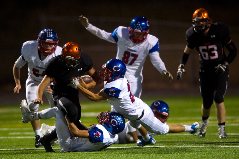 "Erie's running back Noah Roper is tackled by Centaurus' Christian Varga during the game at Erie High School on Friday.<br /> More photos:  <a href=""http://www.BoCoPreps.com"">http://www.BoCoPreps.com</a><br /> (Autumn Parry/Staff Photographer)<br /> September 23, 2016"