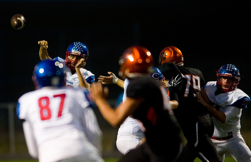 "Centaurus's quarterback Shaquille Ebadi passes the ball to a teammate during the game against Erie at Erie High School on Friday.<br /> More photos:  <a href=""http://www.BoCoPreps.com"">http://www.BoCoPreps.com</a><br /> (Autumn Parry/Staff Photographer)<br /> September 23, 2016"