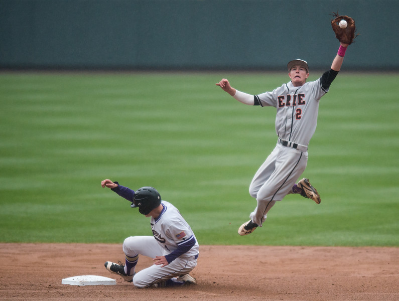 "Erie's Josh Crites leaps for the ball as Holy Family's Wayne Rode slides into second base during the game at Coors Field in Denver on Saturday. The game was rescheduled for Tuesday at Holy Family High School due to bad weather, as thunderstorms rolled through the area. <br /> More photos:  <a href=""http://www.BoCoPreps.com"">http://www.BoCoPreps.com</a><br /> Autumn Parry/Staff Photographer<br /> May 7, 2016"