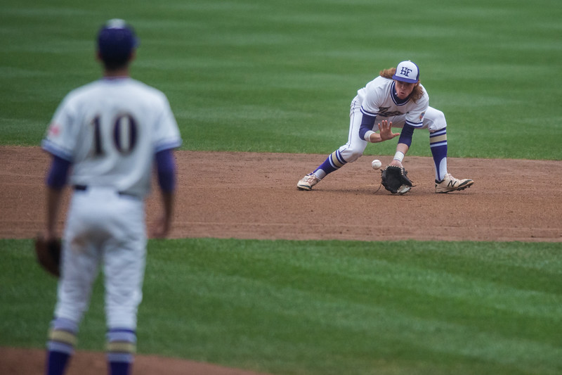 "Holy Family's Jake Karty fields a ground ball during the game against Erie at Coors Field in Denver on Saturday.<br /> More photos:  <a href=""http://www.BoCoPreps.com"">http://www.BoCoPreps.com</a><br /> Autumn Parry/Staff Photographer<br /> May 7, 2016"
