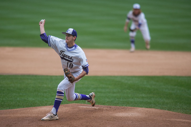 "Holy Family's Griffin Heller pitches against Erie during the game at Coors Field in Denver on Saturday.<br /> More photos:  <a href=""http://www.BoCoPreps.com"">http://www.BoCoPreps.com</a><br /> Autumn Parry/Staff Photographer<br /> May 7, 2016"