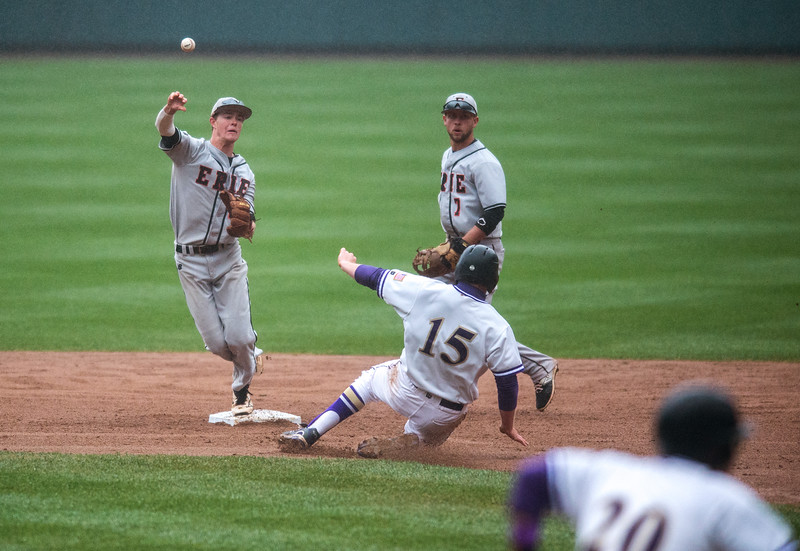 "Erie's Josh Crites tries to turn a double play against Holy Family during the game at Coors Field in Denver on Saturday.<br /> More photos:  <a href=""http://www.BoCoPreps.com"">http://www.BoCoPreps.com</a><br /> Autumn Parry/Staff Photographer<br /> May 7, 2016"