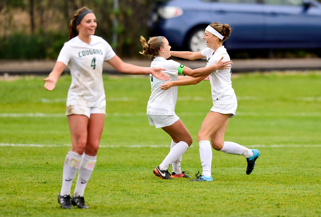 . Niwot High School\'s Sage Marten (No. 16), right, celebrates a goal with teammate Lauren Wolf (No. 5) as Madison Barkow (No. 4) reacts in the game against Erie High School on Wednesday. More photos: BoCoPreps.com. Matthew Jonas/Staff Photographer May 10, 2017